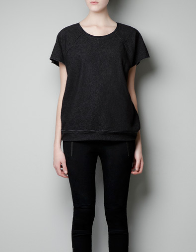 Silk T Shirt - neckline: round neck; pattern: plain; style: blouson; back detail: contrast pattern/fabric at back; predominant colour: black; occasions: casual, work; length: standard; fibres: cotton - mix; fit: straight cut; sleeve length: short sleeve; sleeve style: standard; texture group: jersey - clingy; pattern type: fabric; season: a/w 2012