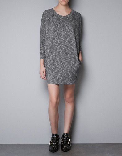 T Shirt Dress - style: t-shirt; length: mid thigh; neckline: round neck; fit: loose; predominant colour: mid grey; occasions: casual; fibres: cotton - mix; sleeve length: long sleeve; sleeve style: standard; texture group: jersey - clingy; pattern type: fabric; pattern size: light/subtle; pattern: patterned/print; season: a/w 2012