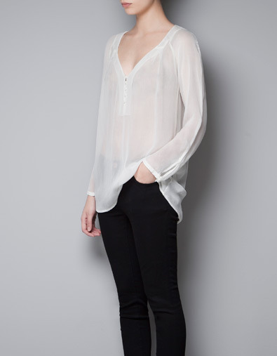 Silk Georgette Top - neckline: low v-neck; pattern: plain; bust detail: sheer at bust; length: below the bottom; predominant colour: ivory/cream; occasions: casual, evening, work; style: top; fibres: polyester/polyamide - 100%; fit: loose; sleeve length: long sleeve; sleeve style: standard; texture group: sheer fabrics/chiffon/organza etc.; pattern type: fabric; season: a/w 2012; wardrobe: basic