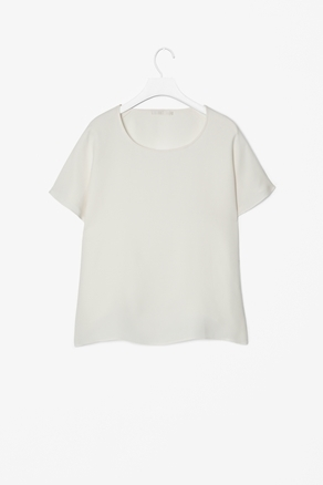 Short Sleeved Silk Top - neckline: round neck; pattern: plain; style: t-shirt; predominant colour: white; occasions: casual, evening, work, occasion; length: standard; fibres: silk - 100%; fit: straight cut; sleeve length: short sleeve; sleeve style: standard; texture group: silky - light; pattern type: fabric; pattern size: standard; season: a/w 2012