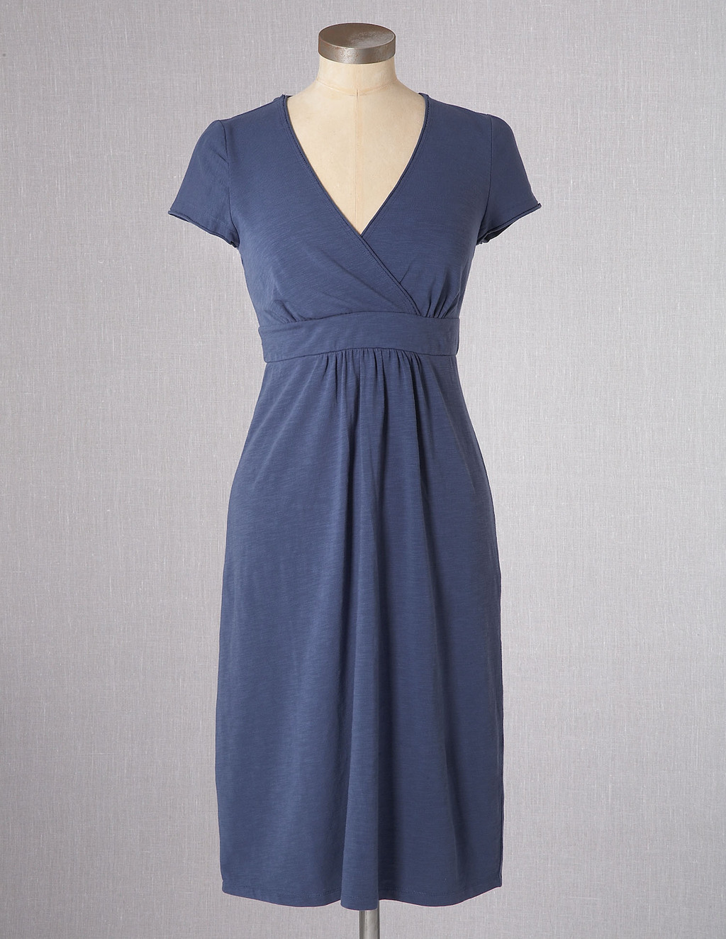 Casual Jersey Dress - style: shift; neckline: v-neck; pattern: plain; predominant colour: royal blue; occasions: casual; length: on the knee; fit: soft a-line; fibres: cotton - stretch; waist detail: narrow waistband; sleeve length: short sleeve; sleeve style: standard; pattern type: fabric; texture group: other - light to midweight; season: s/s 2013