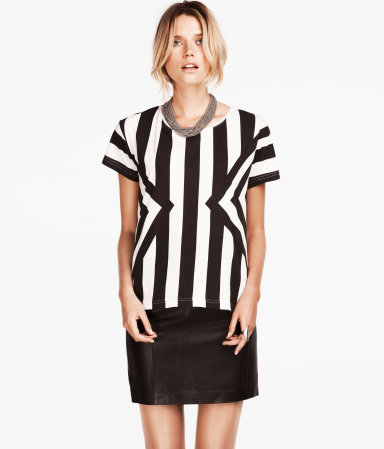 Top - neckline: round neck; pattern: striped; style: t-shirt; secondary colour: white; predominant colour: black; occasions: casual, evening, work; length: standard; fibres: polyester/polyamide - 100%; fit: straight cut; sleeve length: short sleeve; sleeve style: standard; trends: striking stripes, monochrome; pattern type: fabric; texture group: jersey - stretchy/drapey; season: a/w 2012; pattern size: big & busy (top)