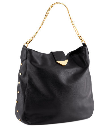 Bag - predominant colour: black; occasions: casual, work; type of pattern: light; style: tote; length: shoulder (tucks under arm); size: standard; material: faux leather; embellishment: studs; pattern: plain; finish: plain; season: a/w 2012