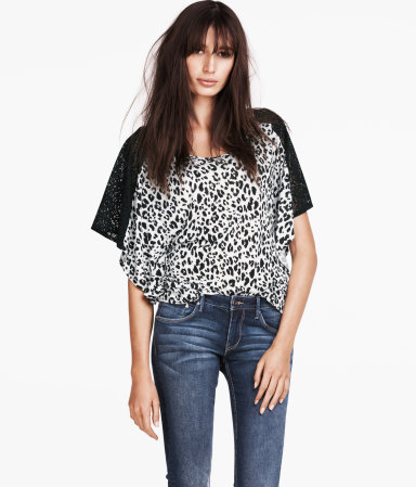 Top - neckline: round neck; sleeve style: dolman/batwing; style: t-shirt; shoulder detail: contrast pattern/fabric at shoulder; predominant colour: black; occasions: casual, evening, work; length: standard; fibres: polyester/polyamide - 100%; fit: loose; sleeve length: short sleeve; trends: statement prints; pattern type: fabric; pattern size: standard; pattern: animal print; texture group: jersey - stretchy/drapey; season: a/w 2012