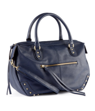 Bag - predominant colour: navy; occasions: casual, creative work; type of pattern: small; style: tote; length: handle; size: standard; material: faux leather; embellishment: studs; pattern: plain; finish: plain; season: a/w 2012