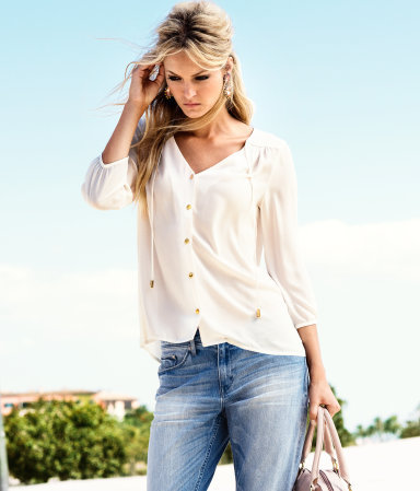 Blouse - neckline: low v-neck; pattern: plain; style: blouse; predominant colour: white; occasions: casual, work; length: standard; fibres: polyester/polyamide - 100%; fit: loose; shoulder detail: flat/draping pleats/ruching/gathering at shoulder; sleeve length: 3/4 length; sleeve style: standard; texture group: sheer fabrics/chiffon/organza etc.; pattern type: fabric; season: a/w 2012