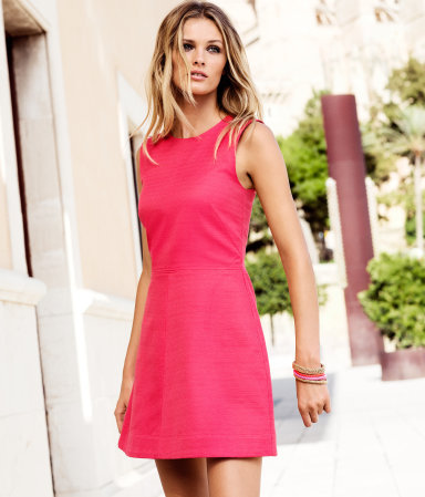 Dress - length: mid thigh; pattern: plain; sleeve style: sleeveless; waist detail: fitted waist; predominant colour: pink; occasions: casual, evening; fit: fitted at waist & bust; style: fit & flare; fibres: cotton - 100%; neckline: crew; sleeve length: sleeveless; texture group: cotton feel fabrics; pattern type: fabric; season: a/w 2012