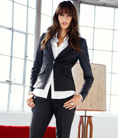 Jacket - pattern: plain; style: single breasted blazer; collar: standard lapel/rever collar; predominant colour: black; occasions: casual, work; length: standard; fit: tailored/fitted; fibres: polyester/polyamide - mix; waist detail: fitted waist; bust detail: contrast pattern/fabric/detail at bust; sleeve length: long sleeve; sleeve style: standard; collar break: low/open; pattern type: fabric; texture group: other - light to midweight; season: a/w 2012; hip detail: front pockets at hip