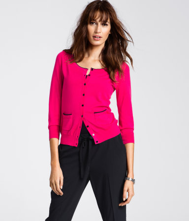 Cardigan - neckline: round neck; pattern: plain; predominant colour: pink; occasions: casual, work; length: standard; style: standard; fibres: cotton - mix; fit: standard fit; waist detail: front pockets at waist level; sleeve length: 3/4 length; sleeve style: standard; trends: fluorescent; pattern type: knitted - other; pattern size: light/subtle; texture group: jersey - stretchy/drapey; season: a/w 2012