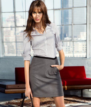 Skirt - length: mid thigh; pattern: plain, herringbone/tweed; fit: body skimming; waist detail: fitted waist, embellishment at waist/feature waistband; hip detail: front pockets at hip, draws attention to hips; waist: mid/regular rise; predominant colour: mid grey; occasions: casual, work; style: a-line; fibres: polyester/polyamide - mix; pattern type: fabric; texture group: other - light to midweight; season: a/w 2012; pattern size: light/subtle (bottom)