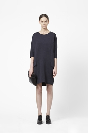 Textured Jersey Dress - style: t-shirt; neckline: round neck; sleeve style: dolman/batwing; fit: loose; pattern: plain; hip detail: front pockets at hip; predominant colour: navy; occasions: casual, evening; length: just above the knee; fibres: polyester/polyamide - 100%; sleeve length: 3/4 length; pattern type: knitted - fine stitch; texture group: jersey - stretchy/drapey; season: a/w 2012