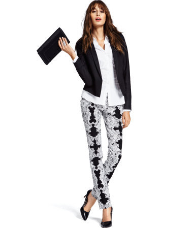 Trousers - length: standard; pocket detail: small back pockets, pockets at the sides; waist: mid/regular rise; predominant colour: black; occasions: casual, evening, work; fibres: cotton - stretch; waist detail: narrow waistband; texture group: crepes; trends: statement prints, modern geometrics; fit: slim leg; pattern type: fabric; pattern: patterned/print; style: standard; season: a/w 2012; pattern size: big & busy (bottom)