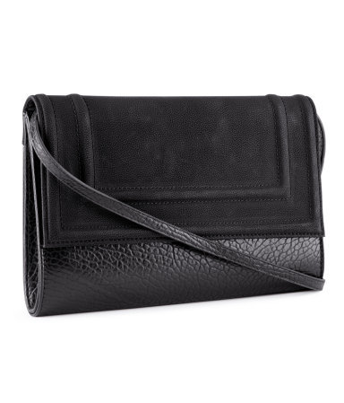 Clutch - predominant colour: black; occasions: casual, evening, occasion; type of pattern: standard; style: clutch; length: hand carry; size: standard; material: faux leather; pattern: plain; finish: plain; season: a/w 2012