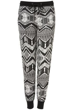Aztec Joggers - length: standard; style: tracksuit pants; waist detail: belted waist/tie at waist/drawstring; waist: mid/regular rise; predominant colour: black; occasions: casual; fibres: cotton - mix; texture group: cotton feel fabrics; trends: modern geometrics; fit: slim leg; pattern type: fabric; pattern: patterned/print; season: a/w 2012; pattern size: big & busy (bottom)