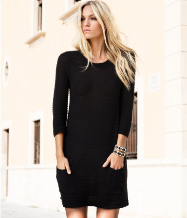 Dress - style: jumper dress; length: mid thigh; neckline: round neck; pattern: plain; hip detail: front pockets at hip; predominant colour: black; occasions: casual, evening, work; fit: straight cut; fibres: acrylic - 100%; sleeve length: 3/4 length; sleeve style: standard; texture group: knits/crochet; pattern type: knitted - other; pattern size: standard; season: s/s 2013