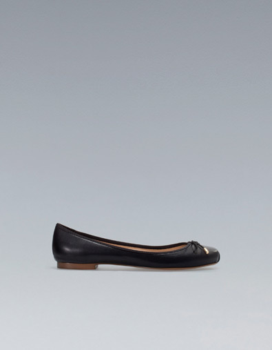 Ballerina - predominant colour: black; occasions: casual, work; material: faux leather; heel height: flat; toe: square toe; style: ballerinas / pumps; finish: plain; pattern: plain; embellishment: bow; season: s/s 2013