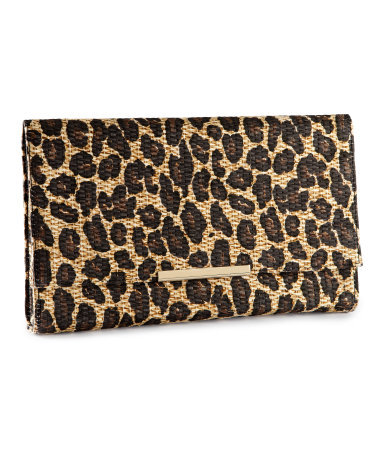 Clutch - predominant colour: tan; occasions: casual, evening, occasion; type of pattern: standard; style: clutch; length: hand carry; size: small; material: macrame/raffia/straw; pattern: animal print; trends: statement prints; finish: plain; season: s/s 2013