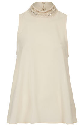 Embellished High Neck Shell Top - sleeve style: sleeveless; neckline: high neck; length: below the bottom; predominant colour: ivory/cream; occasions: casual, evening, work; style: top; fibres: polyester/polyamide - 100%; fit: loose; back detail: keyhole/peephole detail at back; sleeve length: sleeveless; pattern type: fabric; pattern size: standard; texture group: other - light to midweight; embellishment: beading; season: s/s 2013
