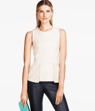 Top - neckline: round neck; pattern: plain; sleeve style: sleeveless; waist detail: peplum waist detail; predominant colour: ivory/cream; occasions: casual, evening, work; length: standard; style: top; fibres: polyester/polyamide - mix; fit: body skimming; sleeve length: sleeveless; texture group: crepes; pattern type: fabric; season: s/s 2013