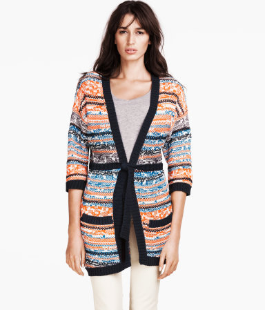 Cardigan - neckline: low v-neck; length: below the bottom; hip detail: front pockets at hip; shoulder detail: contrast pattern/fabric at shoulder; style: open front; occasions: casual, work; fibres: cotton - mix; fit: standard fit; waist detail: belted waist/tie at waist/drawstring; bust detail: contrast pattern/fabric/detail at bust; predominant colour: multicoloured; sleeve length: 3/4 length; sleeve style: standard; texture group: knits/crochet; trends: striking stripes; pattern type: knitted - other; pattern: patterned/print; season: s/s 2013; pattern size: big & busy (top); multicoloured: multicoloured