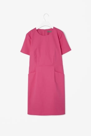 Side Pocket Dress - style: shift; neckline: round neck; pattern: plain; waist detail: twist front waist detail/nipped in at waist on one side/soft pleats/draping/ruching/gathering waist detail; predominant colour: pink; length: just above the knee; fit: straight cut; fibres: cotton - stretch; sleeve length: short sleeve; sleeve style: standard; texture group: crepes; pattern type: fabric; occasions: creative work; season: s/s 2013