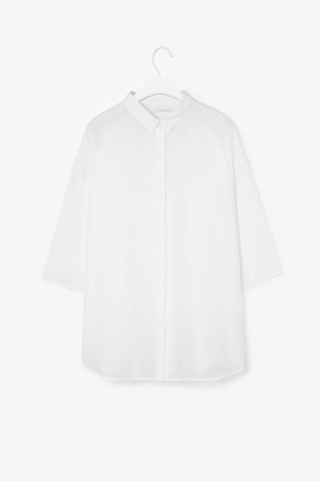 Sheer Textured Shirt - neckline: shirt collar/peter pan/zip with opening; pattern: plain; length: below the bottom; style: shirt; bust detail: buttons at bust (in middle at breastbone)/zip detail at bust; predominant colour: white; occasions: casual, work; fibres: cotton - mix; fit: straight cut; sleeve length: 3/4 length; sleeve style: standard; pattern type: fabric; pattern size: standard; texture group: other - light to midweight; season: s/s 2013