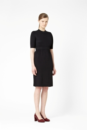 Textured Knit Dress - style: shift; pattern: plain; waist detail: fitted waist, feature waist detail; predominant colour: black; occasions: casual, evening, work, occasion; length: on the knee; fit: soft a-line; fibres: cotton - mix; neckline: crew; hip detail: sculpting darts/pleats/seams at hip; sleeve length: half sleeve; sleeve style: standard; trends: glamorous day shifts; pattern type: fabric; pattern size: standard; texture group: jersey - stretchy/drapey; season: s/s 2013
