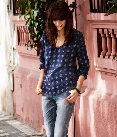 Blouse - neckline: low v-neck; style: blouse; predominant colour: navy; occasions: casual; length: standard; fibres: polyester/polyamide - 100%; fit: loose; hip detail: dip hem; back detail: longer hem at back than at front; sleeve length: long sleeve; sleeve style: standard; texture group: cotton feel fabrics; trends: modern geometrics; pattern type: fabric; pattern size: light/subtle; pattern: patterned/print; season: s/s 2013