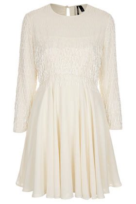 Beaded Fringe Flippy Dress - length: mid thigh; neckline: round neck; pattern: plain; shoulder detail: contrast pattern/fabric at shoulder; predominant colour: ivory/cream; occasions: evening; fit: fitted at waist & bust; style: fit & flare; fibres: polyester/polyamide - 100%; back detail: keyhole/peephole detail at back; sleeve length: long sleeve; sleeve style: standard; texture group: sheer fabrics/chiffon/organza etc.; pattern type: fabric; embellishment: beading; season: s/s 2013