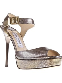 'Linda' Sandal - predominant colour: gold; occasions: evening, occasion, holiday; material: leather; ankle detail: ankle strap; heel: stiletto; toe: open toe/peeptoe; style: standard; finish: metallic; pattern: animal print; heel height: very high; trends: excess embellishment; shoe detail: platform; season: s/s 2013