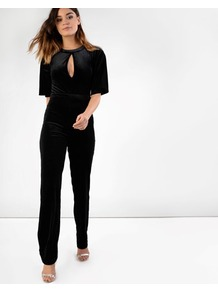 Velvet Jumpsuit - length: standard; sleeve style: dolman/batwing; pattern: plain; predominant colour: black; occasions: evening; fit: body skimming; neckline: peep hole neckline; fibres: polyester/polyamide - stretch; hip detail: structured pleats at hip; sleeve length: half sleeve; style: jumpsuit; pattern type: fabric; texture group: velvet/fabrics with pile; season: a/w 2016; wardrobe: event; trends: velvet