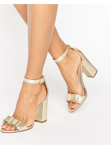 Flounce Gold Bow Heeled Sandals Gold Synthetic - predominant colour: gold; occasions: evening, occasion; material: faux leather; ankle detail: ankle strap; heel: block; toe: open toe/peeptoe; style: strappy; finish: patent; pattern: plain; embellishment: bow; heel height: very high; season: a/w 2016; wardrobe: event
