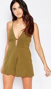 Halter Playsuit With Eyelet Detail Khaki - neckline: plunge; sleeve style: spaghetti straps; pattern: plain; length: short shorts; predominant colour: khaki; occasions: evening; fit: body skimming; fibres: polyester/polyamide - stretch; sleeve length: sleeveless; style: playsuit; pattern type: fabric; texture group: jersey - stretchy/drapey; embellishment: studs; season: a/w 2016; wardrobe: event; embellishment location: bust