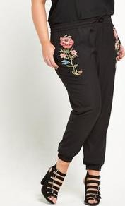 Cuffed Hem Embroidered Pants Black - style: tracksuit pants; waist detail: belted waist/tie at waist/drawstring; waist: mid/regular rise; secondary colour: coral; predominant colour: black; occasions: casual, creative work; length: ankle length; fibres: polyester/polyamide - 100%; texture group: silky - light; fit: tapered; pattern type: fabric; pattern: florals; embellishment: embroidered; wardrobe: highlight; season: s/s 2017; embellishment location: hip