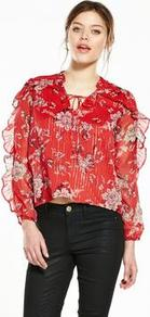 Floral Print Frill Blouse - neckline: pussy bow; style: blouse; secondary colour: ivory/cream; predominant colour: true red; occasions: casual, creative work; length: standard; fibres: polyester/polyamide - 100%; fit: straight cut; sleeve length: long sleeve; sleeve style: standard; texture group: sheer fabrics/chiffon/organza etc.; pattern type: fabric; pattern size: standard; pattern: florals; wardrobe: highlight; trends: statement sleeves; season: s/s 2017; embellishment: frills; embellishment location: sleeve/cuff