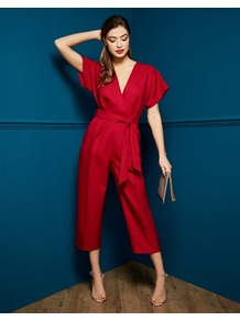 Cross Over Jumpsuit - neckline: low v-neck; sleeve style: dolman/batwing; fit: fitted at waist; pattern: plain; waist detail: belted waist/tie at waist/drawstring; predominant colour: true red; occasions: evening, occasion; length: calf length; fibres: polyester/polyamide - 100%; sleeve length: short sleeve; texture group: crepes; style: jumpsuit; pattern type: fabric; wardrobe: event; season: s/s 2017