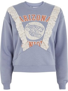 Arizona Lace Detail Sweatshirt By Tee & Cake - style: sweat top; secondary colour: white; predominant colour: denim; occasions: casual; length: standard; fibres: cotton - mix; fit: loose; neckline: crew; sleeve length: long sleeve; sleeve style: standard; pattern type: fabric; texture group: jersey - stretchy/drapey; embellishment: lace; pattern: graphic/slogan; pattern size: big & busy (top); multicoloured: multicoloured; wardrobe: highlight; season: s/s 2017; embellishment location: bust