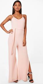 Strap Belted Wide Leg Jumpsuit Nude - length: standard; neckline: v-neck; sleeve style: spaghetti straps; pattern: plain; waist detail: belted waist/tie at waist/drawstring; predominant colour: blush; fit: body skimming; fibres: polyester/polyamide - 100%; occasions: occasion; sleeve length: sleeveless; style: jumpsuit; pattern type: fabric; texture group: jersey - stretchy/drapey; wardrobe: event; season: s/s 2017